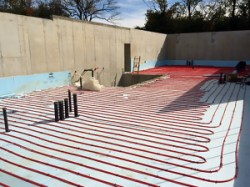 House lower level radiant floor installation