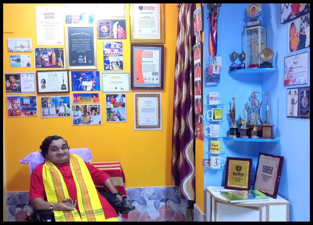 Sai Kaustuv at his house, Puttaparthi, Andhra Pradesh with some of his Awards & Achievements. He has proved that disability can be turned into greatest gift, if you have will power to accept everything.