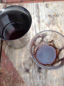Metal jug and transparent glass