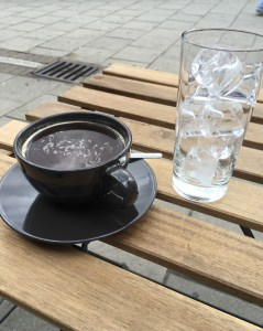 coffee and ice in New Cross on a wooden table