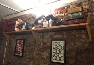 shelf books hats Borough