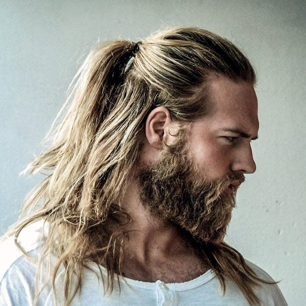 mens long hairbun with beard