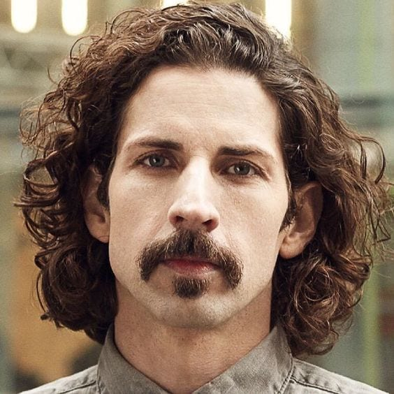 Curly Hair, soul patch and mustache look for men