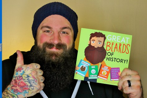 Dad and author Kellen Roggenbuck shows off his new book Great Beards of History!
