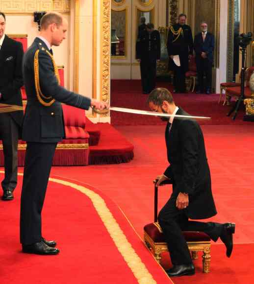 Ringo Starr is knighted by Prince William at Buckingham Palace, 20 March 2018