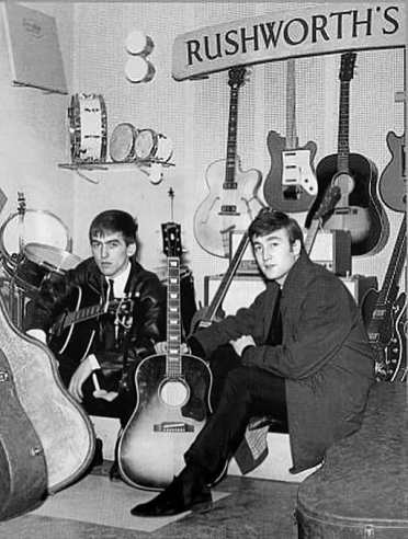 John Lennon and George Harrison receive Gibson J-160E guitars, Rushworth's Music House, Liverpool, September 1962