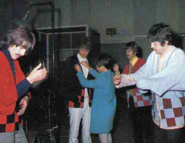 The Beatles with Japanese reporter Rumiko Hoshika, 25 September 1967