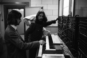 Ringo Starr and George Harrison playing a Moog synthesiser, 1969
