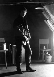 John Lennon in Stuart Sutcliffe's art studio at Astrid Kirchherr's house, 1962