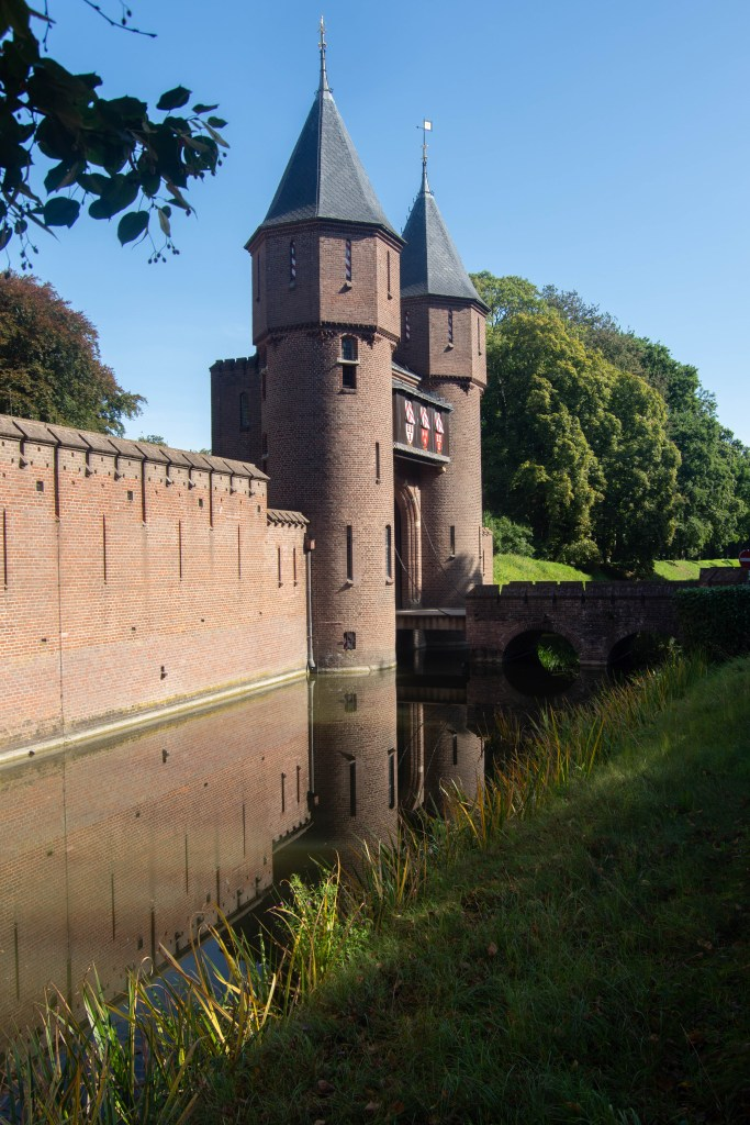 The drawbridge and ramparts next to the moat surrounding the stables