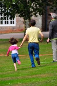 child and man running