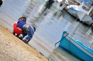 © Beatrice Otto Mykonos boys playing on beach 1