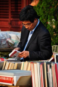 © Beatrice Otto Shanghai book fair young man looking at books
