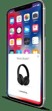 Eine iPhone X mit PopUp der Beats