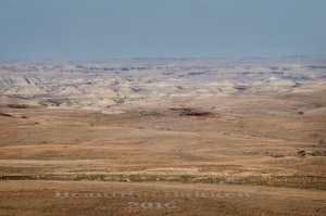 hay field, grasslands and in the distance, the Badlands
