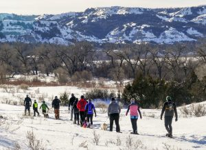 A group of snow shoers trek through the North Dakota Badlands.