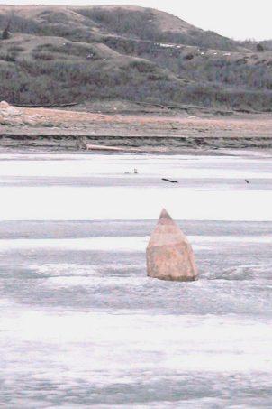 Four Bears Monument pokes through the ice of Lake Sakakawea in 2005.