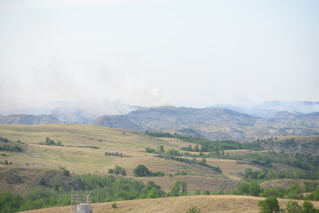 Smoke hovers over the Magpie Creek region of the Badlands in Billings County.