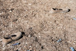 Impractical shoes for hiking the badlands were in a mess of litter.