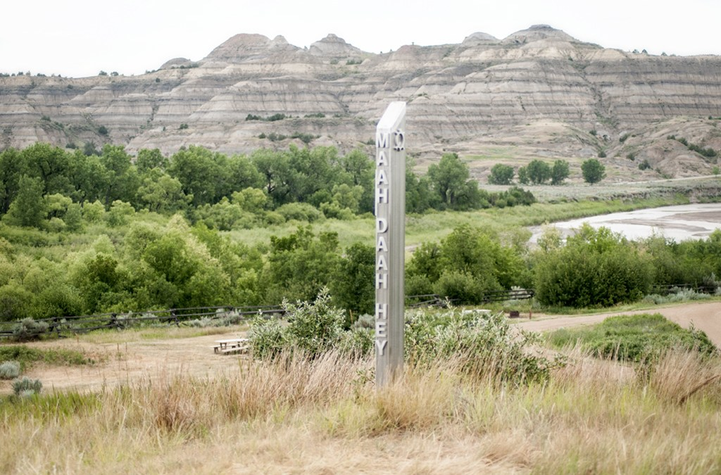 The end of the Maah Daah Hey trail is marked with a metal post above the CCC Campground in the North Dakota Badlands.
