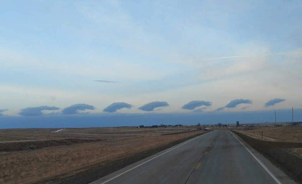 A ripple of clouds over the National Grasslands of North Dakota.