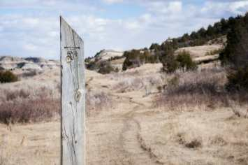 how to photograph the beautiful badlands Bennett Creek Trail marker