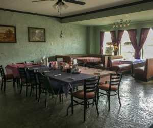 A formal dining area accommodates large groups at Buzzy Cafe in Beach.