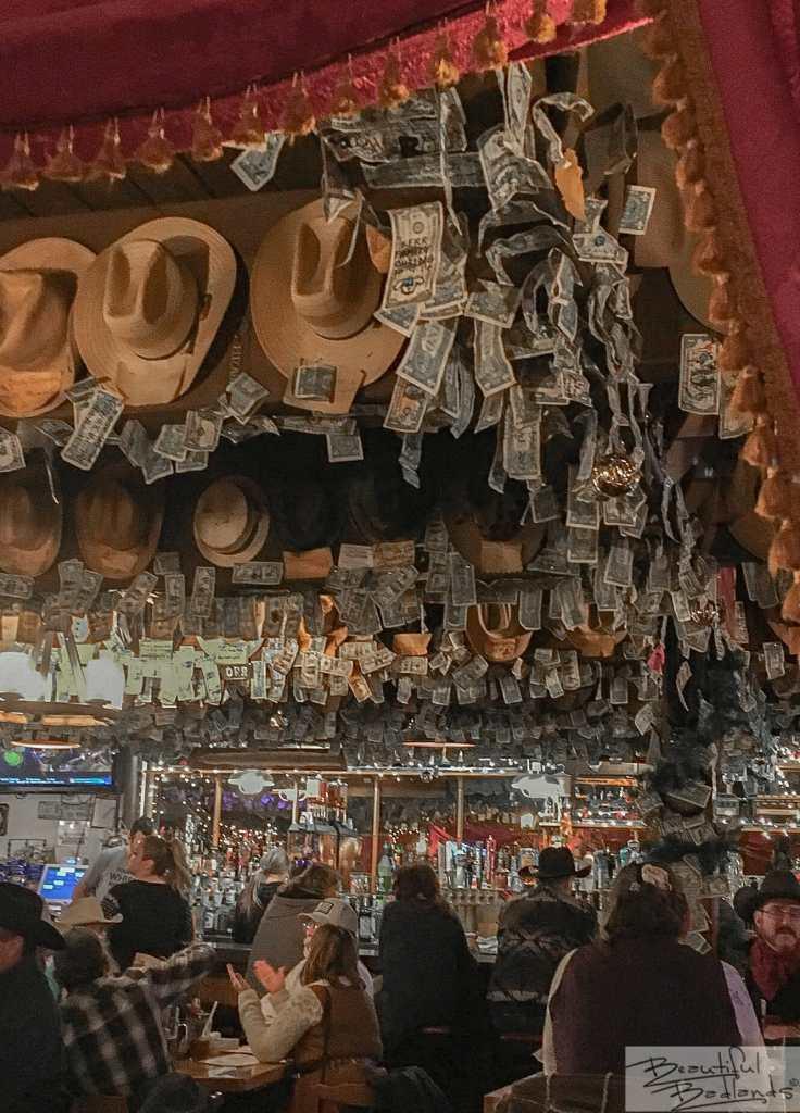 Cowboy Hats and Dollar Bills. And Happy People! Little Missouri Saloon & Dining, Medora, North Dakota