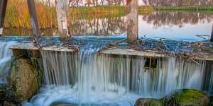 water over the painted creek dam