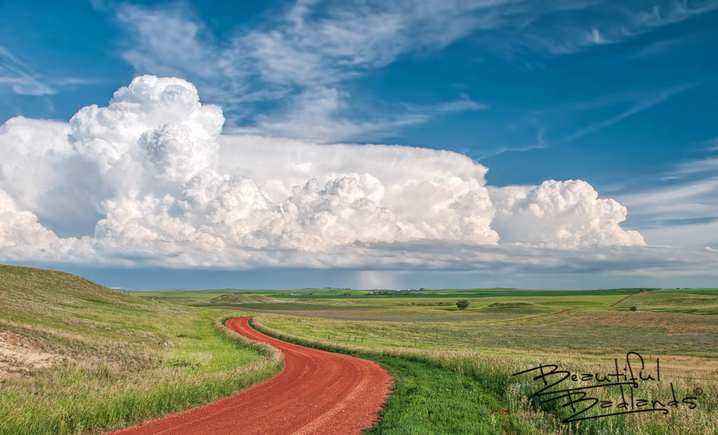 Red Road and Summer Storms in the Green Grasslands, North Dakota
