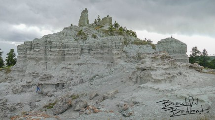 Where's Mike. (very small) hiking up grade in front of north side of Capitol Rock, extreme eastern Montana near Camp Crook, SD July 14, 2020