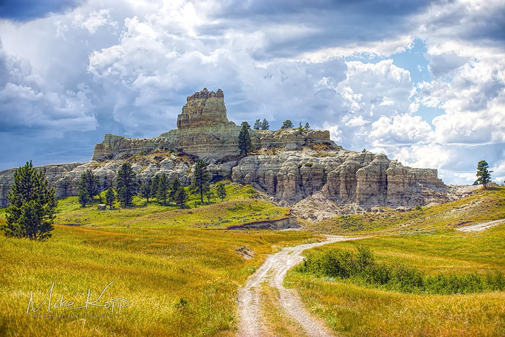 capitol rock, storm clouds, two track trail