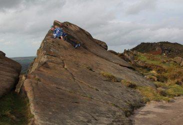 Rock climber on Hen Cloud, The Roaches