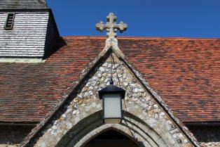 Stone cross above entrance porch, St. Nicholas Church, Itchenor