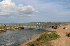 Wooden bridge over Sturt Pond to Saltgrass Lane, Hurst Spit, Milford-on-Sea