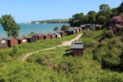 Beach huts and Old Harry Rocks, Middle Beach, Studland
