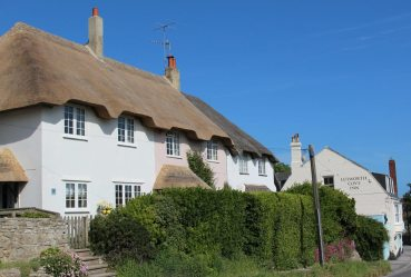 Thatched cottages and Lulworth Cove Inn, Lulworth Cove