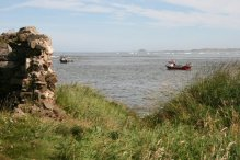 Ruins of Fort Osborne, looking towards Bamburgh Castle, from The Heugh, Holy Island, Lindisfarne