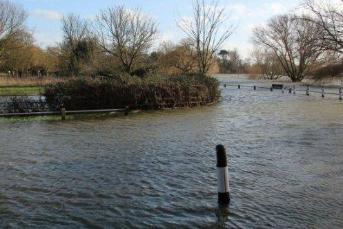 Flooded River Thames, Ferry Lane and Thames Side, Laleham. Floods February 2014