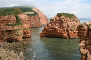Red sandstone cliffs and Hern Rock, next to Ladram Bay, near Sidmouth