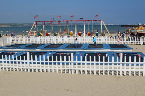 Trampolines and swingboats, beach, Weymouth