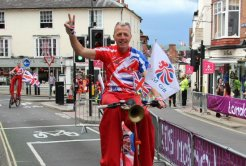 Penny farthing cyclist, Dorking. Women's Olympic Road Cycling Road Race, 2012