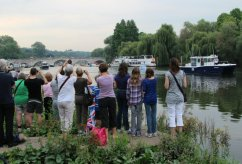 Richmond Bridge and spectators. Olympic Torch, The Gloriana, River Thames, Richmond. 27th July 2012