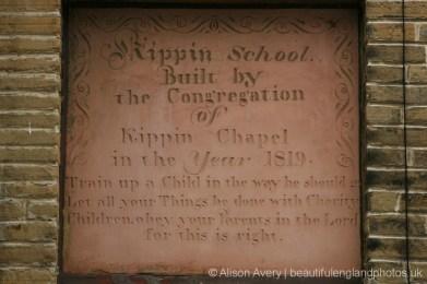 Plaque on the wall of Kippin School, Market Street, thornton
