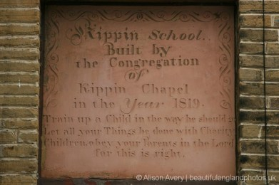 Plaque on the wall of Kippin School, Market Street, thornton