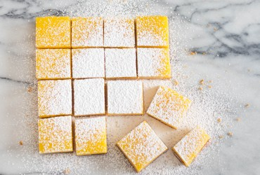 These lemon bars are something of a cross between lemon curd and lemon meringue pie, soft and rich with egg yolks, but thick enough to slice into squares.