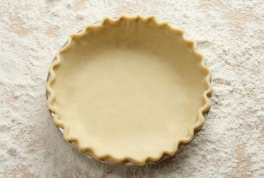 Just smash cold butter in a bowl of flour, stir in a bit of water, roll, and fold. A streamlined blitz, making an easy layered pie dough, supple but strong.