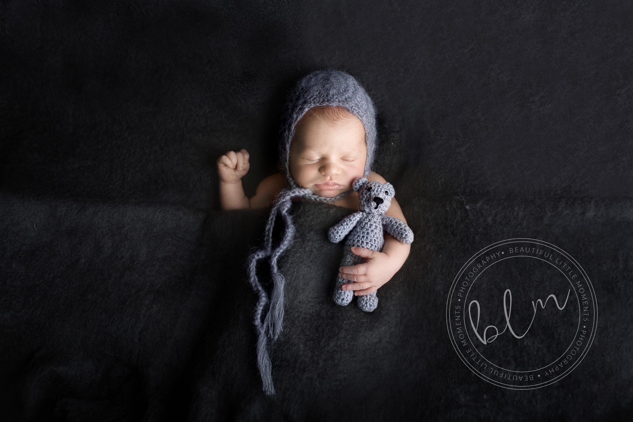 newborn-boy-tucked-up-dark-grey-bonnet-bear-1