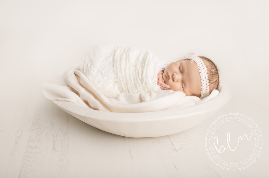 newborn baby girl photo shoot baby wrapped in white