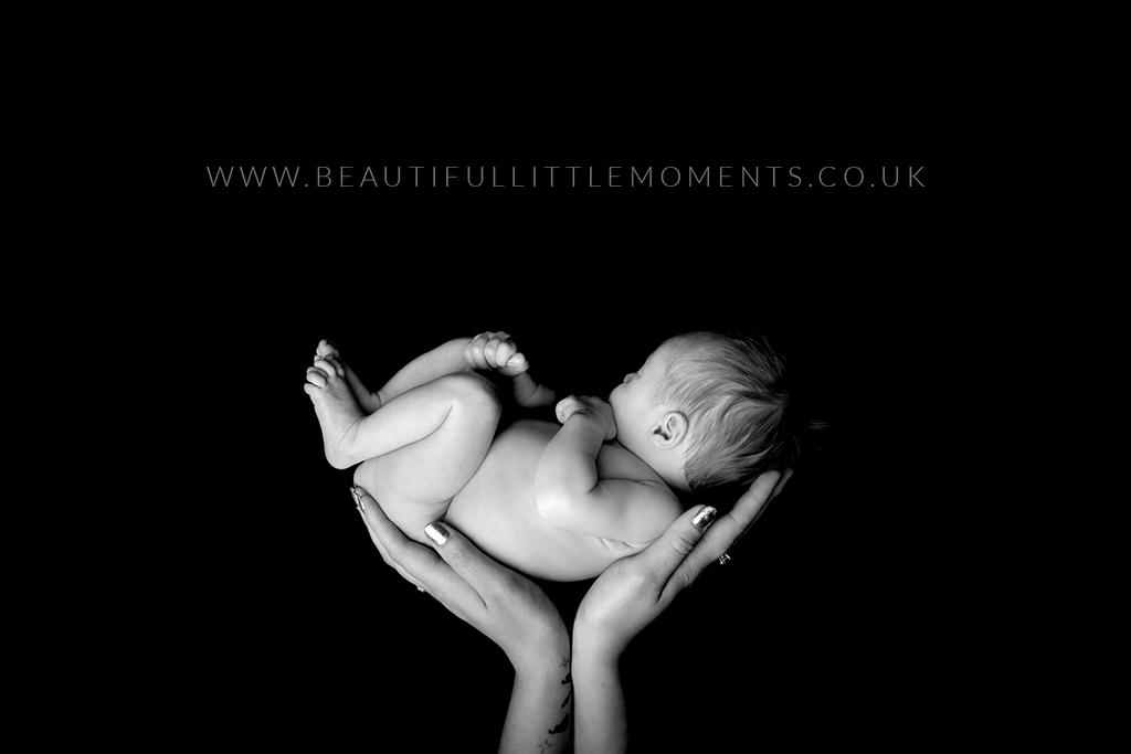 newborn-baby-classic-black-white-mothers-hands-epsom-surrey